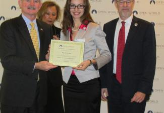 Open World Trustee R. James Nicholson (left) with Olga Shchetinina (center) and Executive Director O'Keefe.