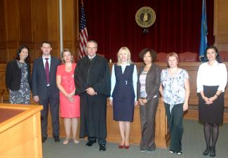 U.S. District Judge Stephen P. Friot (fourth from left) and administrators and faculty from Russia's Lobachevsky State University Faculty of Law visit the Bell Court Room of the University of Oklahoma College of Law.  Judge Friot hosted the delegation for Open World.