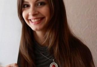 20,000th participant, ms. Olga Shchetinina.